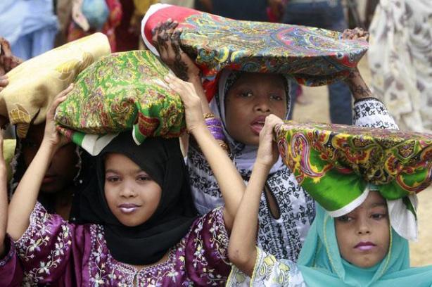 Children celebrate at the shrine of Manghopir on the outskirts of Karachi